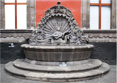 Picture Of Fountain Depicting A Mermaid Playing A Guitar